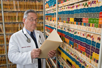 Paper Patient Health Record Charts Viewed by Doctor